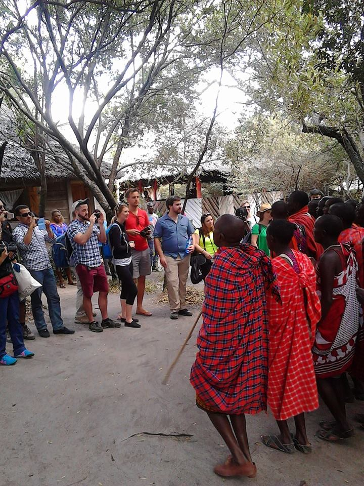 Masai Men (moran) group entertain visiting tourists in Masai Mara