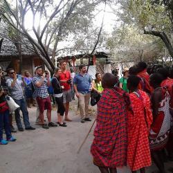 Masai Men (moran) group entertain visiting tourists in Masai Mara